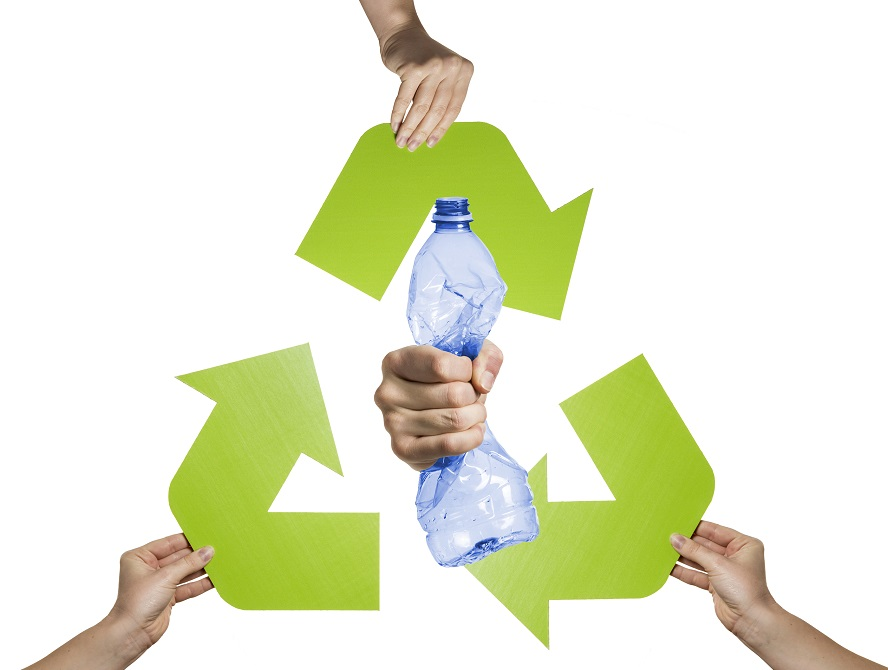 A plastic bottle being crushed with a recycling logo around it