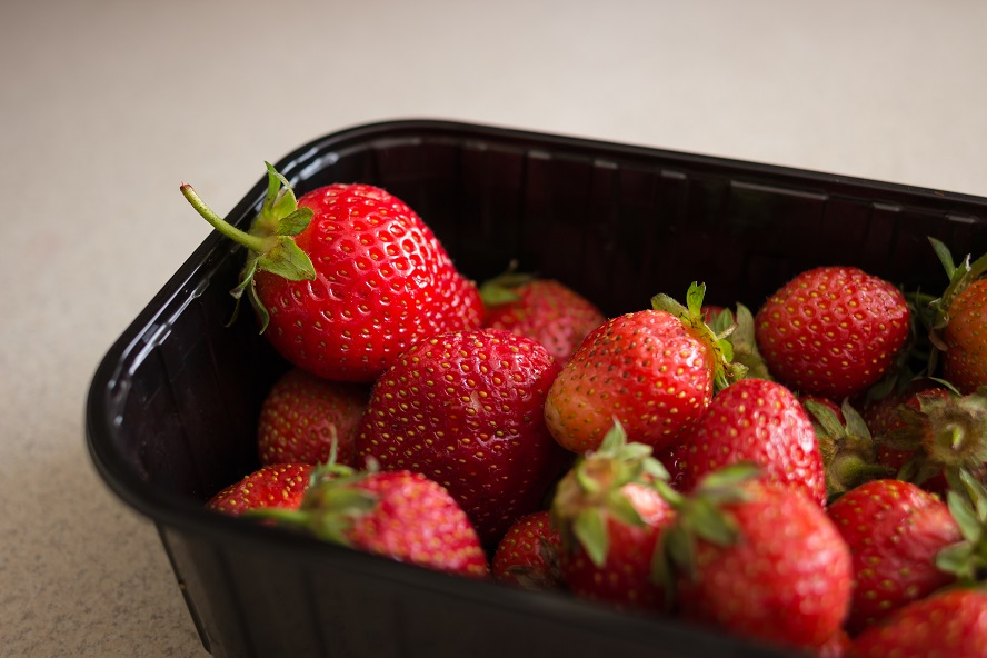 Strawberries in a plastic tray