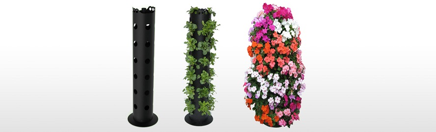 A plastic flower tower with flowers growing out of it