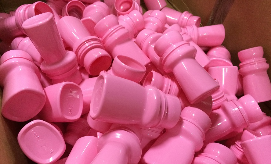 Pink plastic bottles in a box