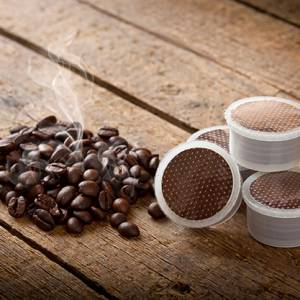Coffee pods and steaming coffee beans